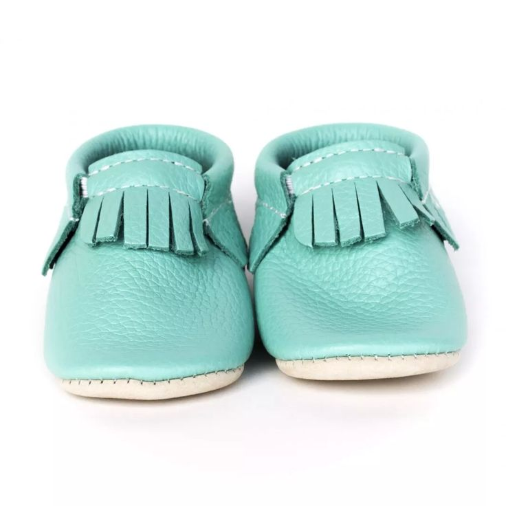 Easter: Robin's Egg is a bright Blue with a hint of green. Minimoc Moccasins have been designed with an elastic at the opening that allows for an easy, slip-on fit, yet keep the shoes on the feet of even the most enthusiastic 'kicker'.