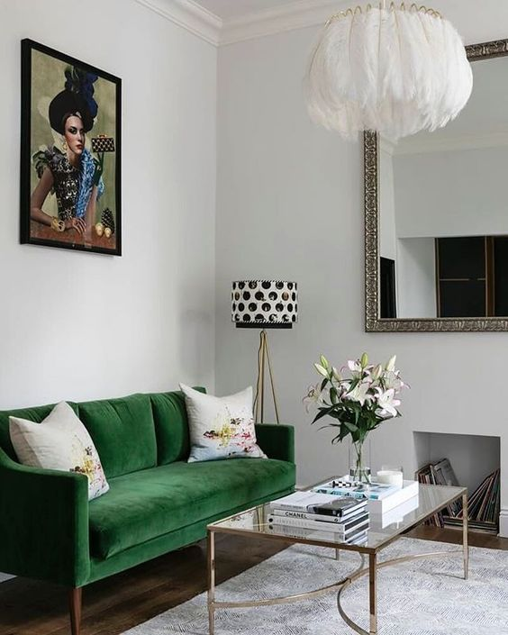 Chic eclectic living room with emerald green sofa