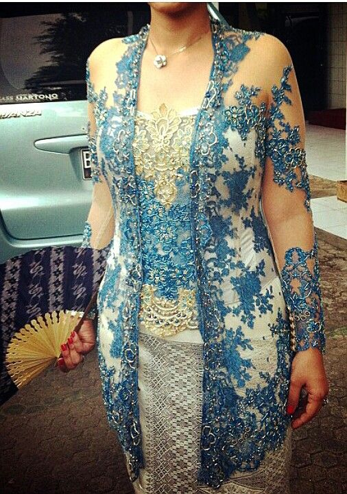 Blue kebaya and white camisol