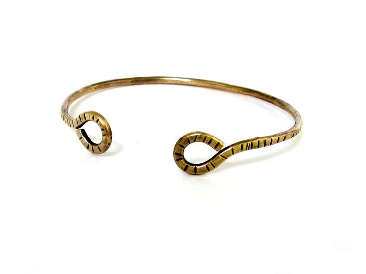Torc bracelet. $24.00, via Etsy.
