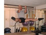 Olympic Trainer, Pilates Instructor Ray Kurshals does Chin up with leg circles.