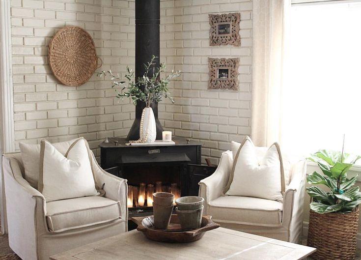 Fireplace corner, slip covered chairs, wood burning stove