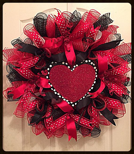 You will love hanging this elegant Black, Red and White Valentines Day Heart Deco Mesh Wreath in your home for the month of February. It shows on a wired form with high quality metallic red, black and white deco mesh. There are ribbons in red white poke a dot, silky striped black
