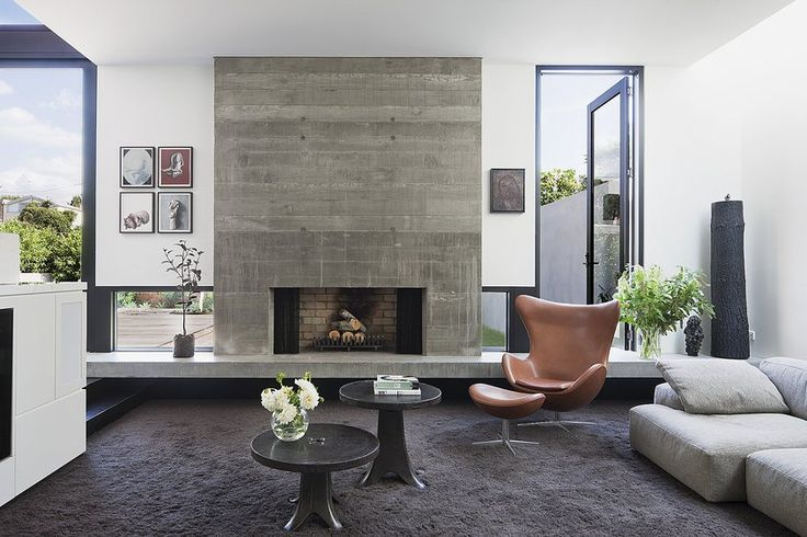 A concrete fireplace surround in a home in Australia.