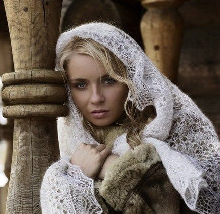 """girl in Russian Orenburg shawl.  This shawl is also known as a """"wedding ring"""" shawl.  It is so fine you can pull it through a ring."""