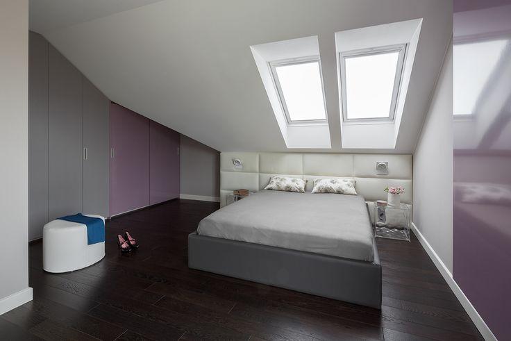 Colourful modern bedroom, bedroom in the attic, leather bed, leather bedhead, white bedhead, dark floor, violet bedroom, grey bedroom