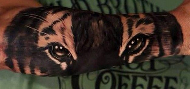 Marvelous tiger eyes tattoo on arm