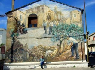 SATRIANO DI LUCANIA, Potenza, Basilicata. Satriano di Lucania is a well-known, unforgettable town in Lucania. The whole inhabited center presents wonderful murals with an important historical and social value of collective representation.