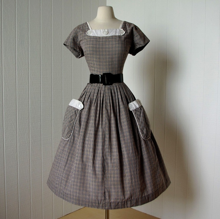 vintage 1950's dress  ...fabulous multi-shade gingham full skirt cotton pin-up bombshell dress waffle pique trim huge pockets big buttons. $160.00, via Etsy.