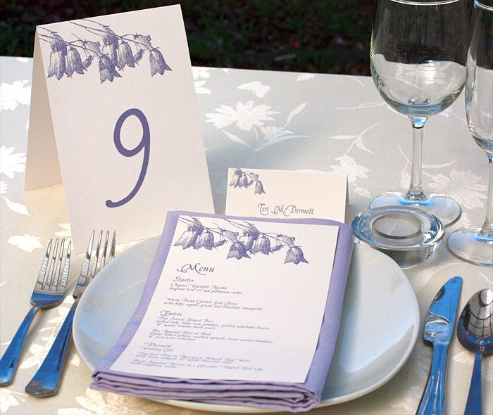 Delicate lavender bluebell floral wedding reception decor with matching table numbers, menus and place cards for a spring or summer wedding.  | Invitations by Ajalon | invitationsbyajalon.com