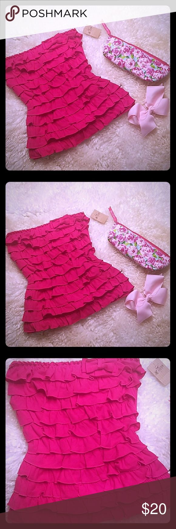 HOLLISTER PINK BOW RUFFLE LAYER STRAPLESS TOP HOLLISTER PINK BOW RUFFLE LAYER STRAPLESS TOP. BRAND NEW WITH TAGS. SMOKE FREE. ABSOLUTELY ADORABLE? SUPER FLIRTY! Hollister Tops