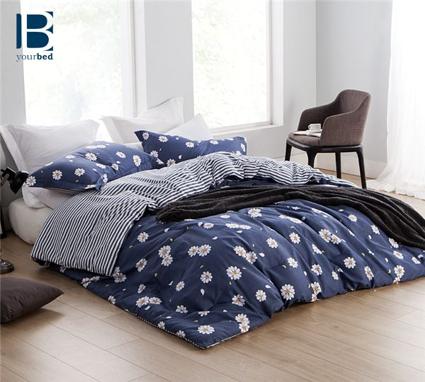 This cute #BYB Daisy Mae Comforter is the perfect accent to a bright and floral bedroom. This #Navy_Comforter is adorned with cute white daisies and it's reverse side has navy and white stripes. Sleep comfortably and cute with this Byourbed Comforter!  #Navy_Bedding #Navy_Decor #Daisy_Decor #Daisy_Bedding #New_Bedding #Best_Comforter #Striped_Bedding #Floral_Bedding #Daisy_Comforter #Cute_Bedding #Cute_Comforter #Byourbed