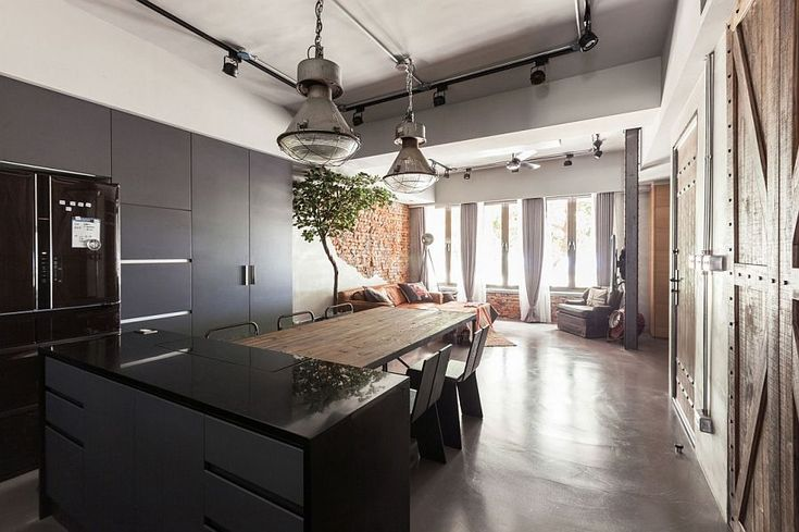 Contemporary kitchen stands next to the vintage living area