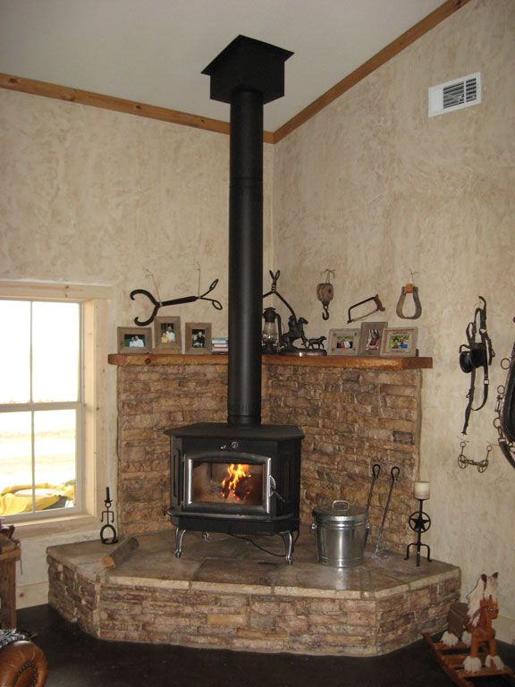 Buck stove on large hearth with HT metal chimney