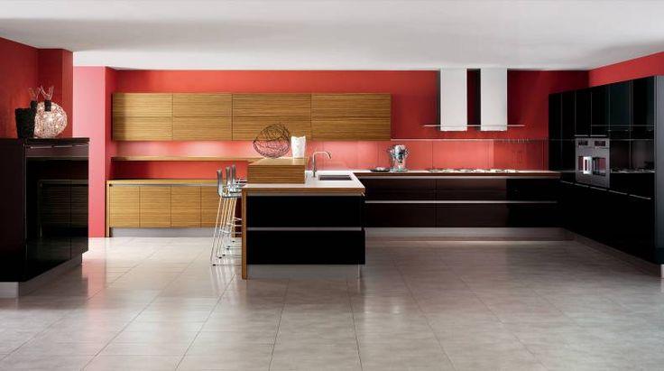 OYSTER  Una cucina che affronta il tema dell'essenzialità offrendo una nuova risposta alla domanda di funzionalità.I brillanti riflessi di modernità dei laccati lucidi con l'avveniristica eleganza dei laccati opachi.