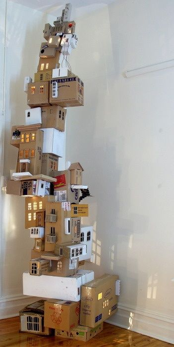 Box Towers :  Cartons, Xmas lights, a few crayons, scissors & a rainy day! l fancy.com
