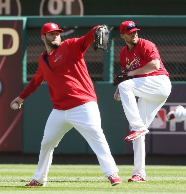 Cardinals practice. Starting pitchers Lance Lynn and John Lackey throw in the outfield