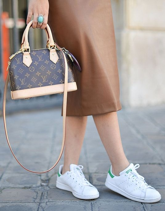 Leather skirt, white sneakers, and Louis Vuitton purse