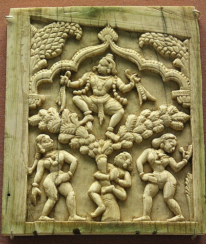 Krishna sitting in a tree. Ivory plaque from Tamil Nadu,16th cent,AD