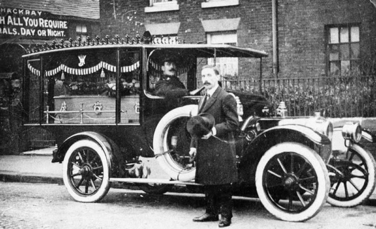 Harry Thackray with his hearse, & uniformed driver, at his undertaking premises in Beeston, Leeds, Yorkshire, which he had until 1921.