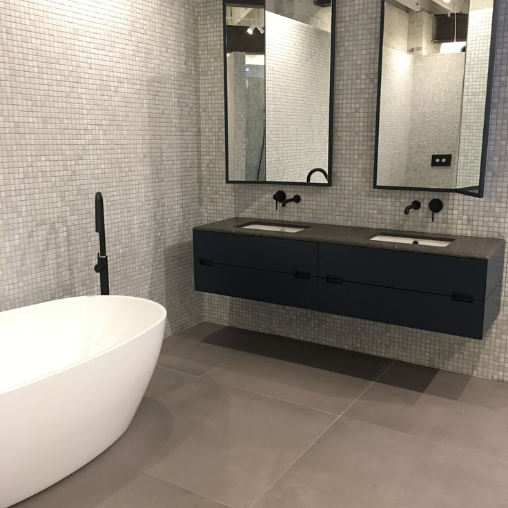 Warehouse Chic flowing through to the bathroom. Black accessories complimenting the look of this space.