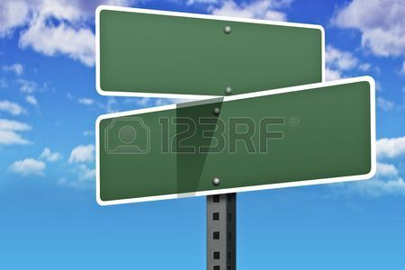 Business slogans on a road and street signs Stock Photo