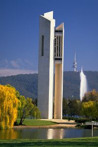On Lake Burley Griffin in Canberra, ACT / National Carillion in foreground, fountain beyond, and Black Mountain Tower (previously known as Telstra Tower and Telecom Tower)which is a telecommunication tower situated above the summit of Black Mountain in Australia's capital city of Canberra, rising 195.2 metres above the mountain summit