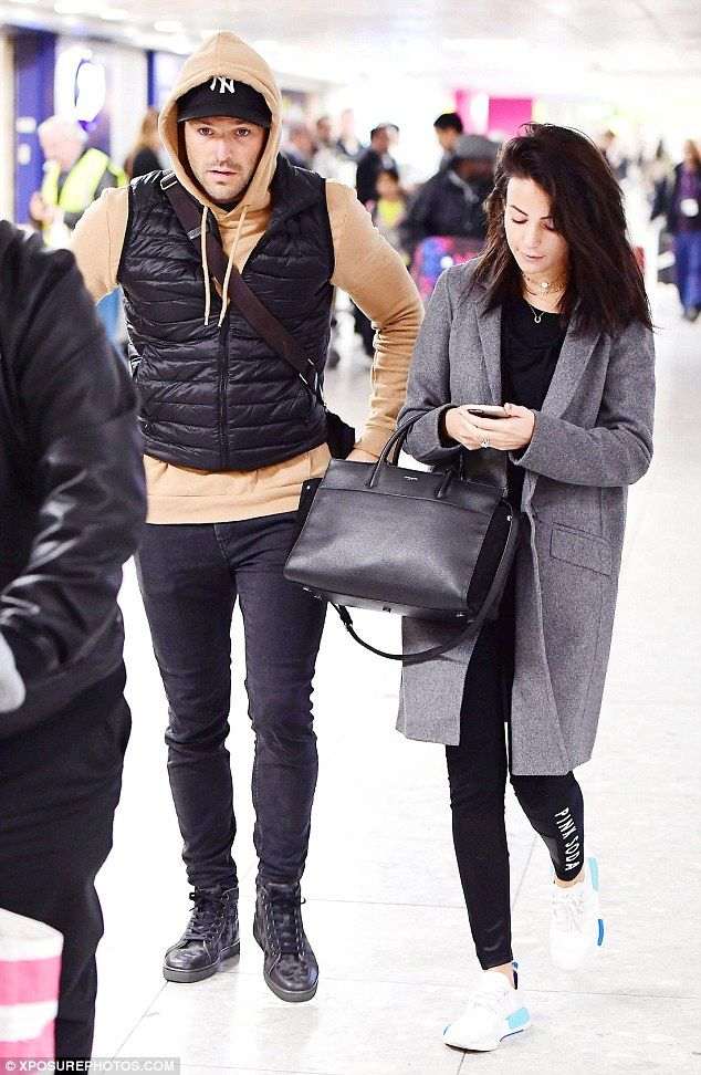 A bit gloomy: Michelle Keegan and Mark Wright jetted into London on Thursday after a Miami holiday