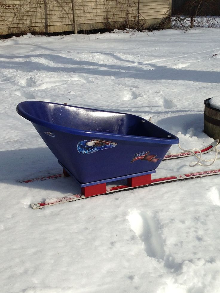 I made this sled out of an old set of skis and a plastic wheelbarrow