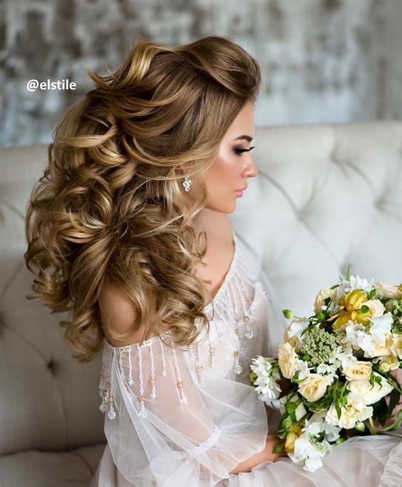 down wedding hairstyle idea via Elstile / http://www.deerpearlflowers.com/26-perfect-wedding-hairstyles-with-glam/