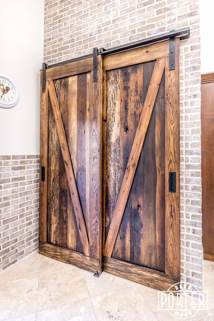 Covering this kitchen pantry are tobacco barn brown bypass for Pantry barn door hardware