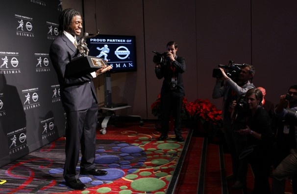 Dec. 10, 2011  Heisman Trophy winner Robert Griffin III holds the award during a news conference in New York.  Craig Ruttle / Associated Press