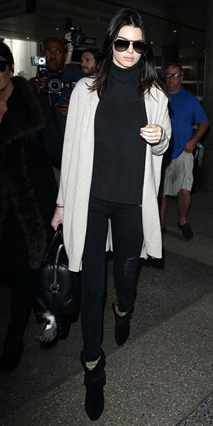 Kendall Jenner at  LAX Airport (March 11, 2015), wearing Dolce & Gabbana sunglasses, a Givenchy bag and a Fendi bag charm, Arthur George by Robert Kardashian Camo Aqua Socks and  Isabel Marant Étoile Rawson Harness Boots. #kendalljenner #style