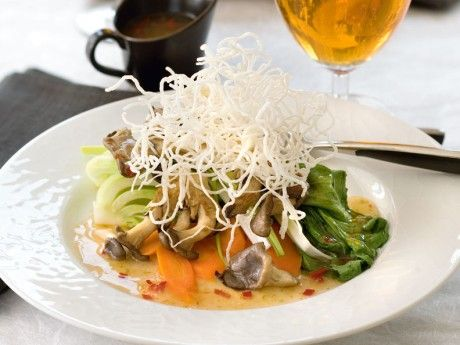 Steamed vegetables with crispy noodles and sweet and sour sauce