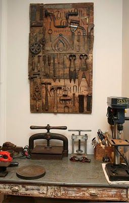 Tools hung on old wood panel in Judy Wilkenfeld's studio - Red Velvet