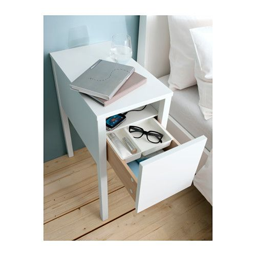 NORDLI Nightstand - IKEA (It has a groove down one of the legs for an outlet strip for chargers)
