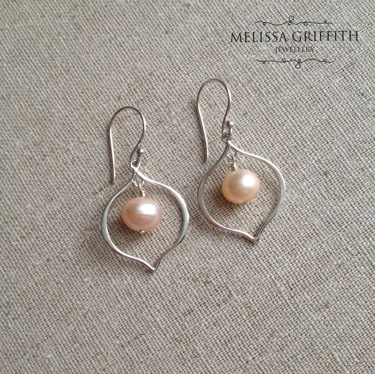 Pearl Arabesque Earrings (MGE94) $40.00 The perfect pair of everyday pearl earrings! These simple, light weight, and elegant earrings will be the modern classic that you throw on with everything. Earrings measure 1.4 inches from top of earring hook.