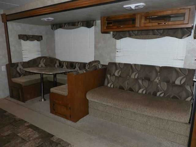 2013 Used Coachmen Catalina Santara 272DBS Travel Trailer in Minnesota MN.Recreational Vehicle, rv, 2013 Coachmen Catalina Santara 272DBS, Camp in style with this preowned 2013 Coachmen Santara 272DBS travel trailer bunkhouse from Noble RV of Owatonna, MN. Featuring one slideout, pullout camp kitchen and rear double bunks.UVW: 6046GVW: 7700U-Shaped DinetteJ-Sleeper SofaTub w/Shower SurroundAwning2-Burner Cook-top for Camp KitchenPower Tongue Jack ,