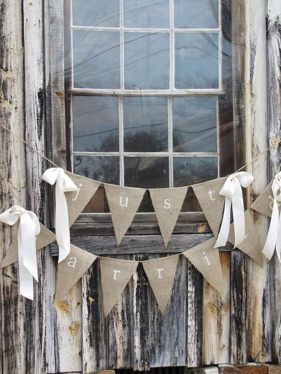 burlap.. would look cool with groom and bride instead of just married for behind the reception or cake table . . . only back with plum fabric