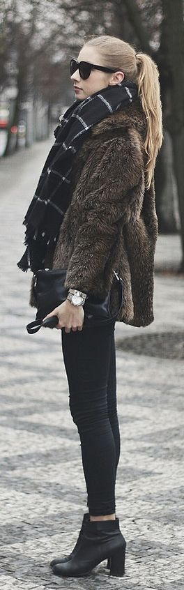 Street Style, January 2015: Pavlína Jágrová is wearing a faux fur jacket from Debenhams, black jeans from TopShop, shoes window pane scarf from Zara and the bag is from C&A
