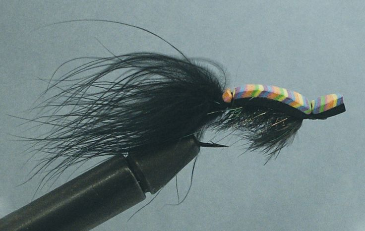 Gurgler fly  Invented by the late Jack Gartside, this surface fly can be used to catch just about every variety of saltwater fish there is—and likely any freshwater fish as well. This example was tied by Gartside himself, and is one of more than one hundred flies Gartside bequeathed to the Museum.