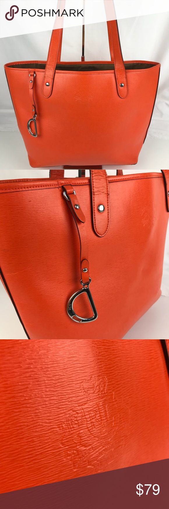 """Ralph Lauren Newberry Classic Orange Tote Authentic. Used. A few marks on bottom exterior and wear on handles. Please see photos.  Lauren Ralph Lauren Newbury Classic Orange Leather Tote Bag Handbag. 14""""L x 9""""H x 4.5""""D with 8.5"""" Strap drop. Silver hardware with hang tag. Zip top. 1 zipper and 4 slip pockets inside. RB1106  Thank you for your interest!   PLEASE - NO TRADES / NO LOW BALL OFFERS / NO OFFERS IN COMMENTS - USE THE OFFER LINK :-) Ralph Lauren Bags Totes"""