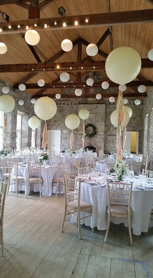 Giant balloons made the perfect centerpieces in this room, with white washed floors, exposed brickwork and high beamed ceilings. #rustic #wedding #balloons  Borris House Balloons: Bubblegum Balloons UK @bubblegumballoo  Venue: Borris House co.Carlow Ireland