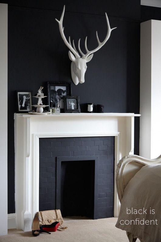 Love the contrast of black/deep charcoal with the white mantel. via Heart Home Magazine: Autumn Sneak Peek