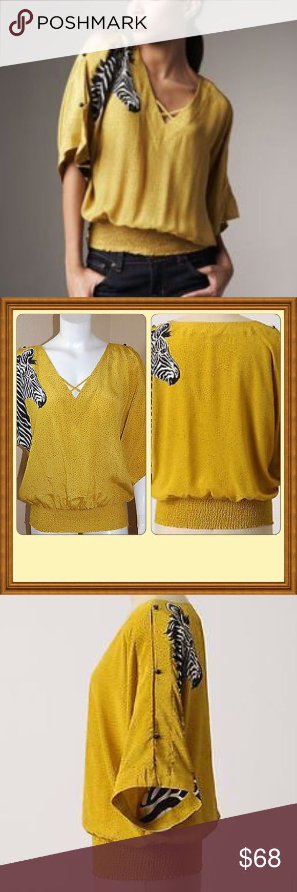 Rare Anthro Leifsdottir yellow zebra batwing top Worn a handful of times but very well taken care of.  An inquisitive zebra is printed on the front and back of a brightly hued pin dot pattern top with an easy, relaxed silhouette. Smooth, silky style is topped with tiny buttons along the split dolman sleeves, while a smocked hem finishes this statement piece. Anthropologie Tops