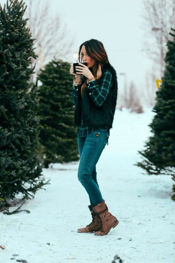 Green and black plaid flannel, black vest, jeans, combat boots