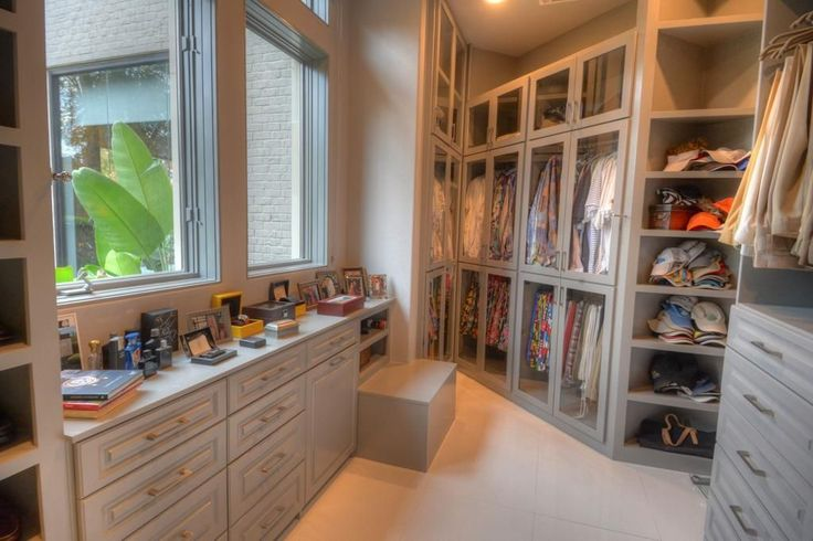 Traditional Closet with sandstone tile floors, Outdoor products colossal utility duffle, Landers 10-watch winder and storage