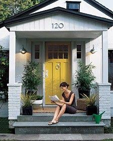 inspiration for my house: gray (brick), black (garage door and shutters), and yellow (front door)
