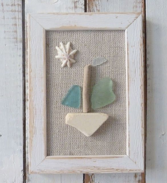 The sea glass, sea pottery and shell finds have been put to use in this picture