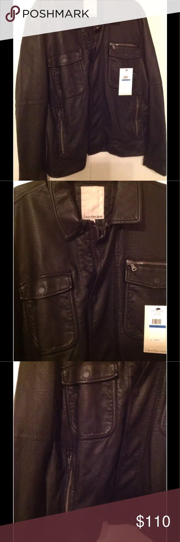 "NWT Calvin Klein Black Faux Leather Moto Coat! XL Awesome Men's Faux Leather Moto Bomber Jacket in Black with Pewter Hardware!  Brand New with Tags! Original Price $198   Adult Mens size XL -- Measurements  **Measurements: Width = Underarm to Underarm 24"" Length = Back of Neck/Collar to Bottom Waist Hem 26""  Lots of pockets. Excellent full front zipper and metal snaps for closure.  This will look great on someone...Enjoy! Think You or Awesome Christmas gift!!! Calvin Klein Jackets & Coats"